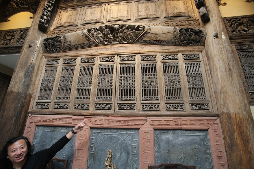 Wood carving in Chinese building being restored