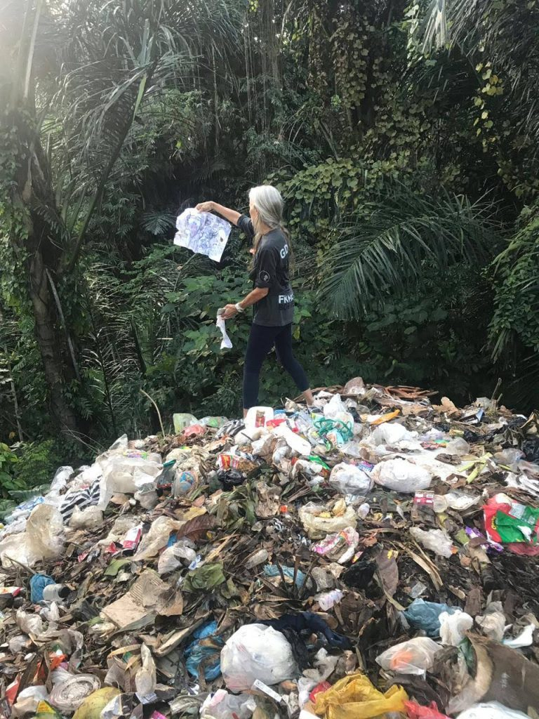 Cynthia Hardy on trash pile
